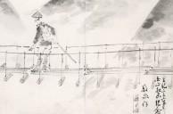 つり橋を渡る登山者